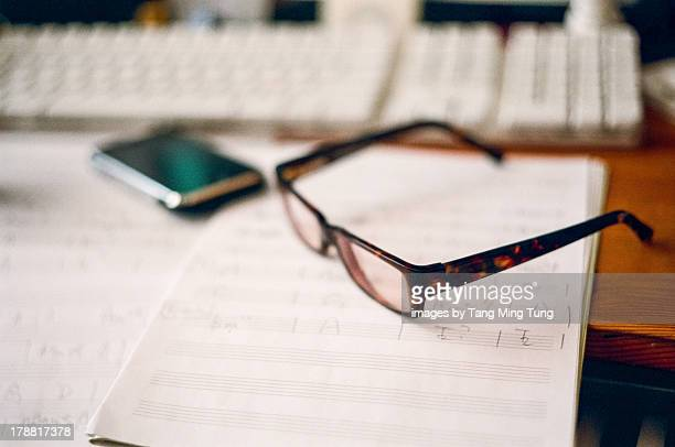 A pair of glasses & musical staff note book