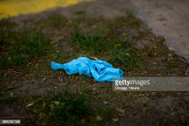 A pair of gloves are left on the 4600 block of North Beacon Street at the scene of what officials have called a domestic dispute that left a...