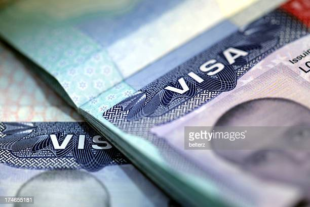 A pair of government visas showing men's photos