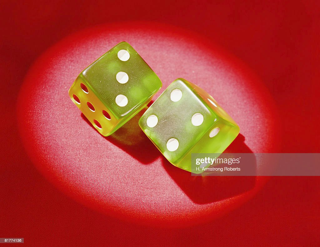 Pair of green plastic dice, showing 'lucky 7'.