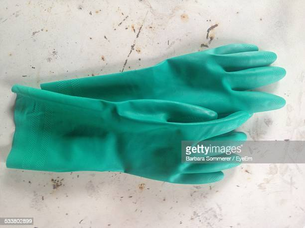 Pair Of Green Washing Up Gloves On Floor