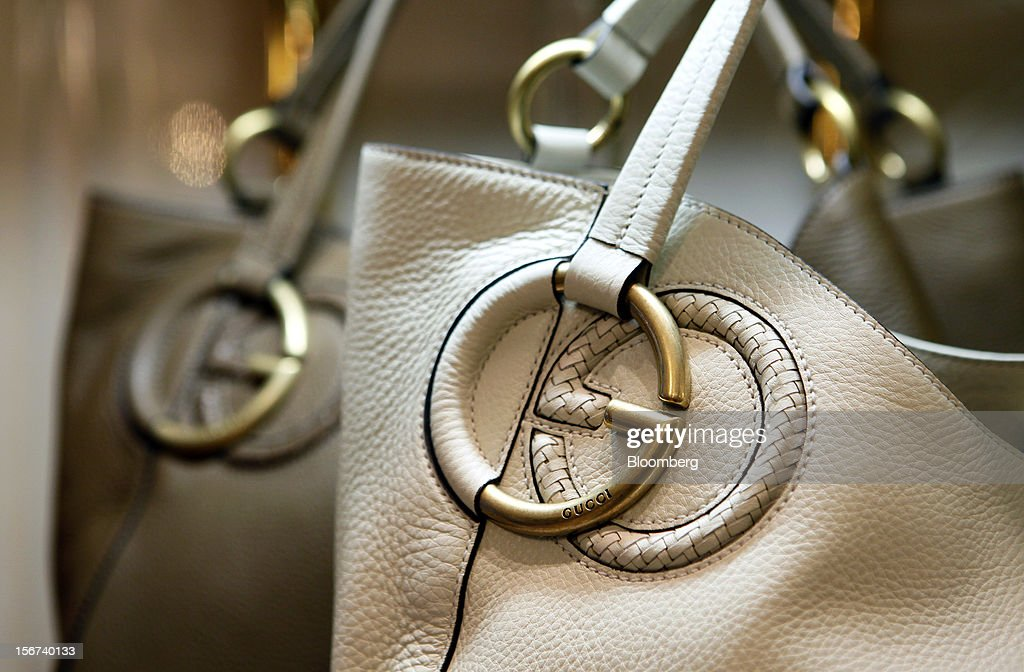 A pair of Gucci 'Twill' bags bearing the interlocking 'G' logo sit displayed for sale inside a Gucci store, a luxury unit of France's PPR SA, in Rome, Italy, on Monday, Nov. 19, 2012. PPR SA, the French owner of the Gucci and Puma brands, said it's confident of revenue and profit growth in 2012. Photographer: Alessia Pierdomenico/Bloomberg via Getty Images
