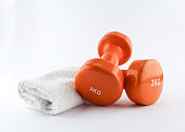 A pair of hand weights and towel. Isolated on white, clipping path
