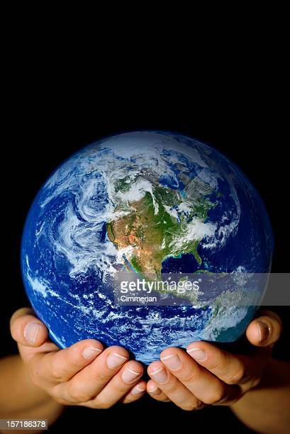 Pair of hands holding the Earth with North America visible