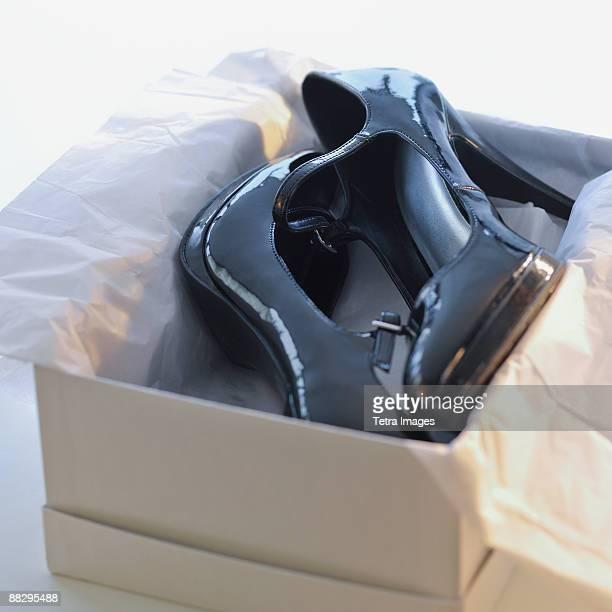 Pair of high heels in box