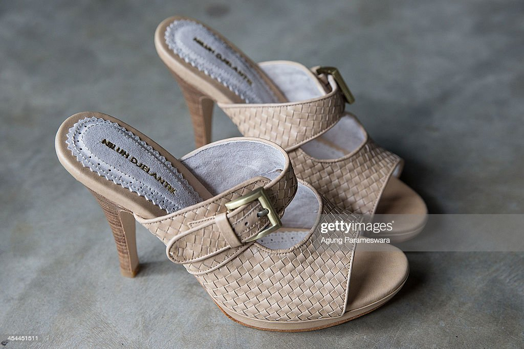 A pair of high heels is seen in display at Niluh Djelantik atelier on November 12, 2013 in Canggu Village, Bali, Indonesia. Niluh Djelantik (formerly called Nilou), the hand made high end leather shoe, is produced by Balinese shoe lover and designer Ni Luh Ayu Pertami with 40 shoes designers and workers in a small atelier at Canggu Village. This brand signature by a unique engraving and designed to be comfortable high heels or wedges with elegan touch. Celebrities like Cate Blanchett, Uma Thurman,Julia Roberts ,Paris Hilton, Cameron Diaz and American top model Gisele Bundchen have been known to purchase Niluh Djelantik beautiful shoes and sandals.