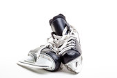 A pair of ice hockey skates isolated on white background with copy space.