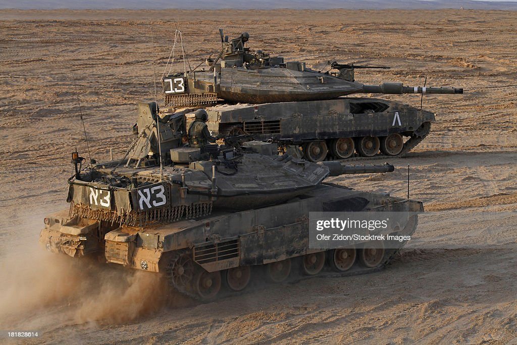 A pair of Israel Defense Force Merkava Mark IV main battle tanks during exercise in the Negev desert.