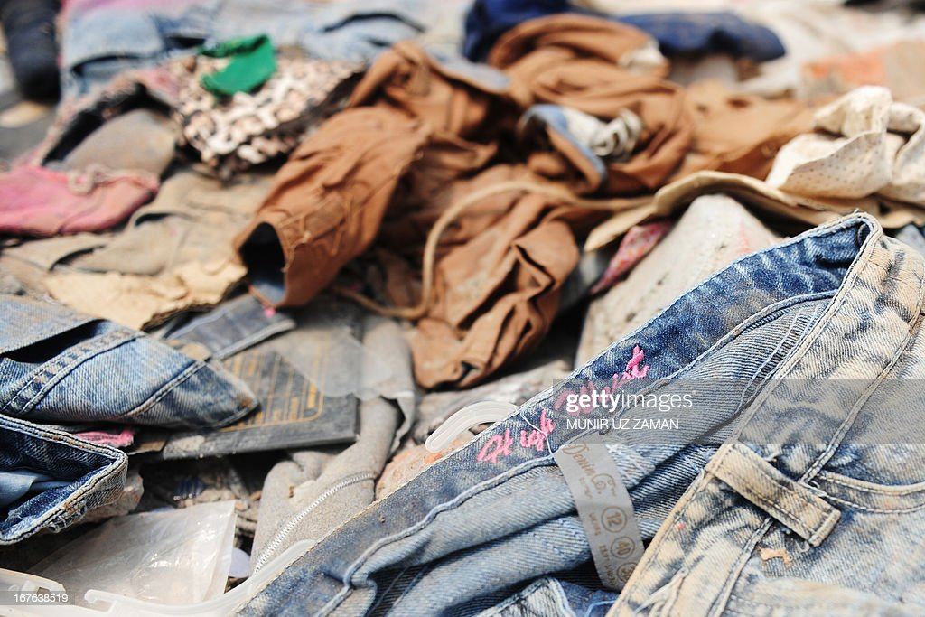 A pair of jeans lies in the rubble three days after a Bangladeshi garment eight-storey building collapsed in Savar, on the outskirts of Dhaka, on April 27, 2013. Police arrested two textile bosses over a Bangladeshi factory disaster as the death toll climbed to 332 and distraught relatives lashed out at rescuers trying to detect signs of life. AFP PHOTO/ Munir uz ZAMAN