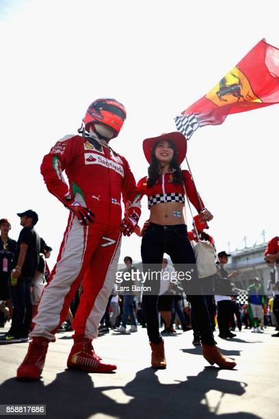 A pair of Kimi Raikkonen of Finland and Ferrari fans show their support before the Formula One Grand Prix of Japan at Suzuka Circuit on October 8...