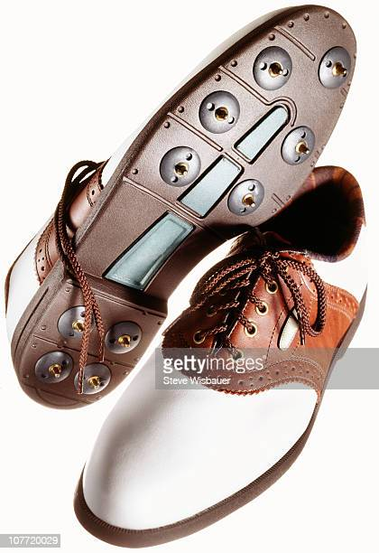 A pair of men's golf shoes