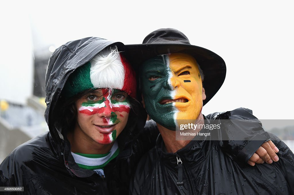 A pair of Mexico fans brave the rain before the 2014 FIFA World Cup Brazil Group A match between Mexico and Cameroon at Estadio das Dunas on June 13, 2014 in Natal, Brazil.