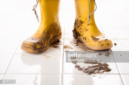 A pair of muddy rubber boots
