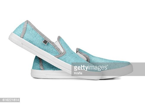 Pair of new light sneakers isolated on a white background : Stockfoto