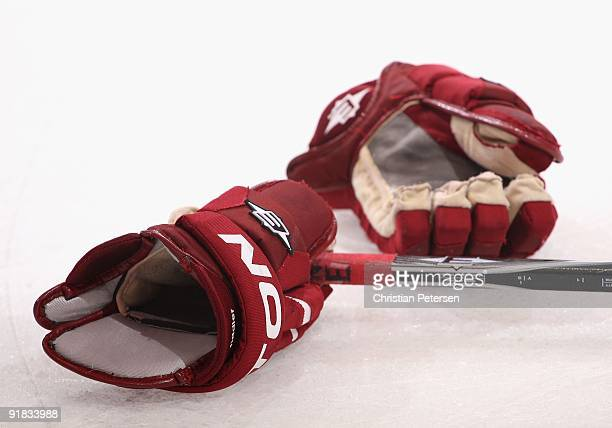 A pair of Phoenix Coyotes gloves on the ice during the NHL game against the Columbus Blue Jackets at Jobingcom Arena on October 10 2009 in Glendale...