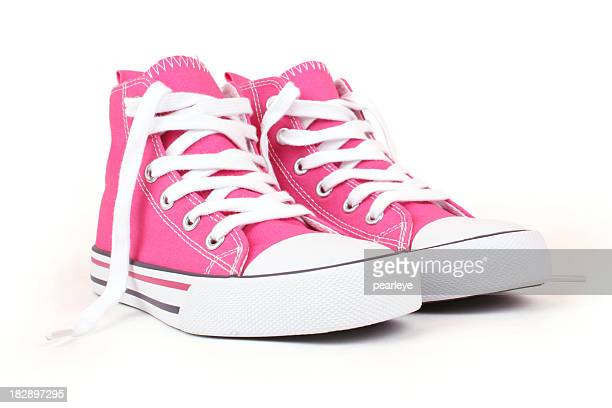 Pair of pink canvas sneakers with white laces
