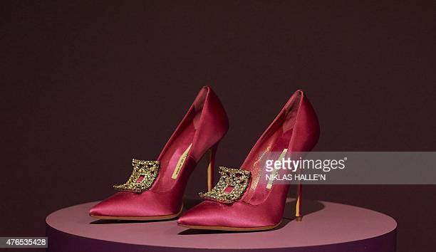 A pair of pink high heel shoes created by designer Manolo Blaniksit sit on display during a photocall for an exhibition entitled 'Shoes Pleasure and...