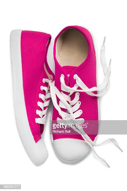 A pair of pink shoes on a white background