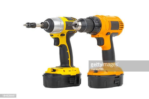 pair of power tools in yellow and orange