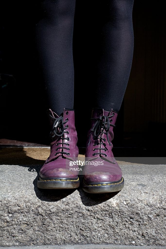 A pair of purple coloured Dr Martens boots