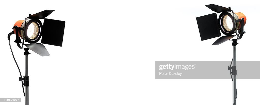 Pair of Red Head film lights on white copy space : Stock Photo