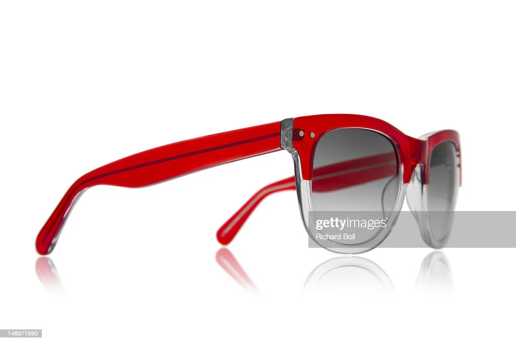 A pair of red sunglasses on a white background : Stock Photo