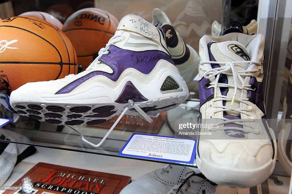 A pair of Reebok custom basketball shoes worn and signed by <a gi-track='captionPersonalityLinkClicked' href=/galleries/search?phrase=Shaquille+O%27Neal&family=editorial&specificpeople=201463 ng-click='$event.stopPropagation()'>Shaquille O'Neal</a> are displayed at the Julien's Auctions press call for Music Icons And Sports Legends Memorabilia Auction at Julien's Auctions Gallery on June 18, 2012 in Beverly Hills, California.