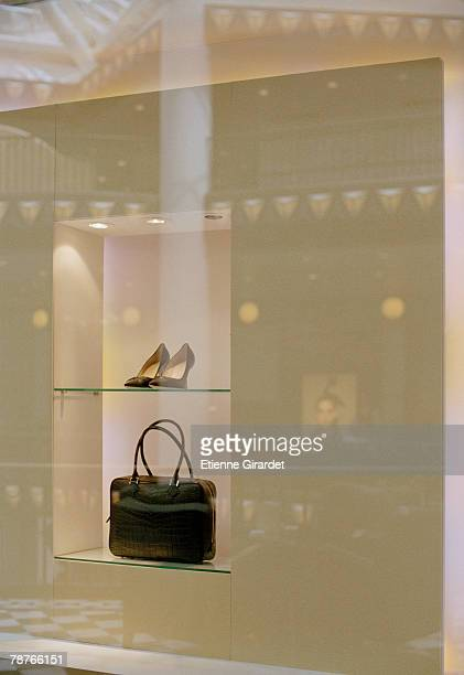 A pair of shoes and a handbag in a shop window display