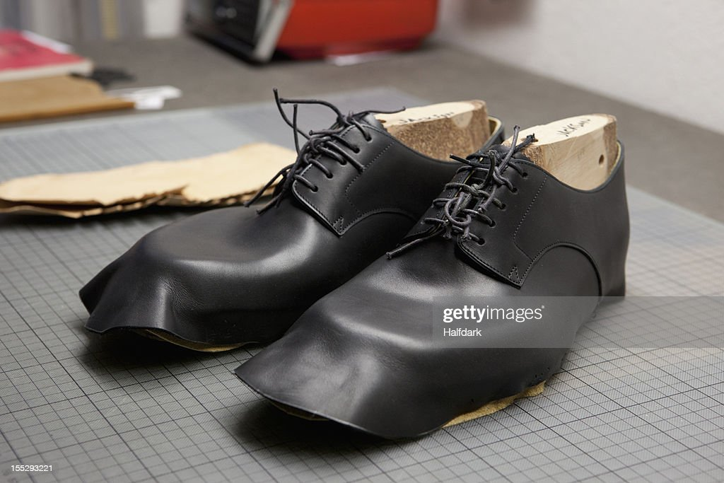A pair of shoes being made