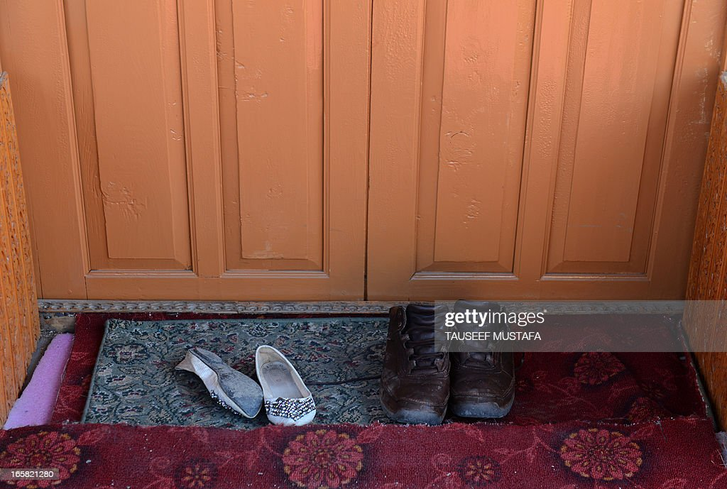 A pair of shoes (L) belonging to a young British woman who was found murdered are pictured on a houseboat in Srinagar on April 6, 2013. A British woman holidaying in Indian Kashmir was found dead 'in a pool of blood' on a houseboat and a Dutch man has been arrested on suspicion of her murder, police said on Saturday. The 43-year-old Dutch national was taken into custody as he tried to flee the scenic Kashmir valley in the foothills of the Himalayas, police superintendent Tahir Sajjad told AFP. AFP PHOTO/Tauseef MUSTAFA