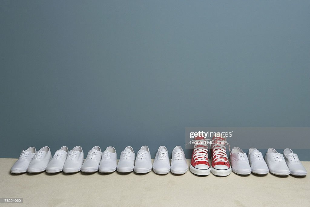 Pair of shoes in row against wall : Stock Photo