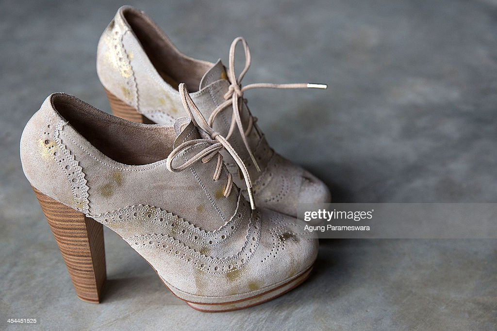 A pair of shoes is seen in display at Niluh Djelantik atelier on November 12, 2013 in Canggu Village, Bali, Indonesia. Niluh Djelantik (formerly called Nilou), the hand made high end leather shoe, is produced by Balinese shoe lover and designer Ni Luh Ayu Pertami with 40 shoes designers and workers in a small atelier at Canggu Village. This brand signature by a unique engraving and designed to be comfortable high heels or wedges with elegan touch. Celebrities like Cate Blanchett, Uma Thurman,Julia Roberts ,Paris Hilton, Cameron Diaz and American top model Gisele Bundchen have been known to purchase Niluh Djelantik beautiful shoes and sandals.