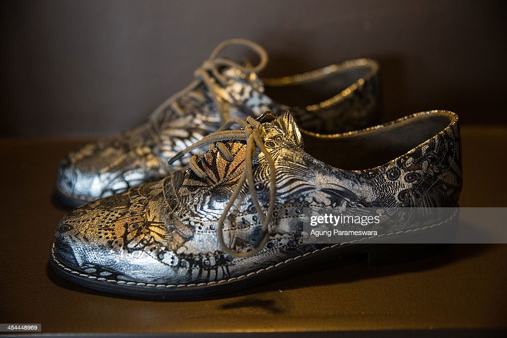 A pair of shoes is seen in display at Niluh Djelantik store on November 12, 2013 in Seminyak, Bali, Indonesia. Niluh Djelantik (formerly called Nilou), the hand made high end leather shoe, is produced by Balinese shoe lover and designer Ni Luh Ayu Pertami with 40 shoes designers and workers in a small atelier at Canggu Village. This brand signature by a unique engraving and designed to be comfortable high heels or wedges with elegan touch. Celebrities like Cate Blanchett, Uma Thurman,Julia Roberts ,Paris Hilton, Cameron Diaz and American top model Gisele Bundchen have been known to purchase Niluh Djelantik beautiful shoes and sandals.