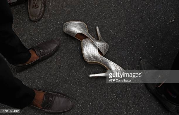 A pair of shoes lay on the street as Indian members and supporters of the lesbian gay bisexual transgender community take part in a pride parade in...