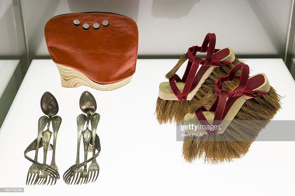 A pair of shoes with the name 'Cutlery' designed by Lauren Johnstone, a shoe with the name 'Shoebag' designed by Astrid Jansen and a pair of shoes 'Brooms' designed by Sol Alonso at the exhibition: 'Starker Auftritt: Experimentelles Schuh Design' (the title is a play on words, as it means both 'Strong Appearance' and 'Strong Step', coupled to 'Experimental Show Design') at the Grassi Museum on March 27, 2013 in Leipzig, Germany. The exhibition features over 200 pairs of shoes, many of them designed for celebrities and which challenge traditional notions of shoe design. The exhibition will run until September 28, 2013.