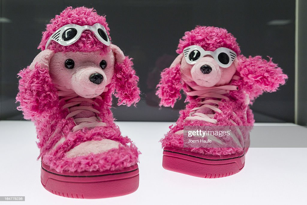 A pair of shoes with the name 'Pink Poodle' designed by Jeremy Scott and adidas at the exhibition: 'Starker Auftritt: Experimentelles Schuh Design' (the title is a play on words, as it means both 'Strong Appearance' and 'Strong Step', coupled to 'Experimental Show Design') at the Grassi Museum on March 27, 2013 in Leipzig, Germany. The exhibition features over 200 pairs of shoes, many of them designed for celebrities and which challenge traditional notions of shoe design. The exhibition will run until September 28, 2013.