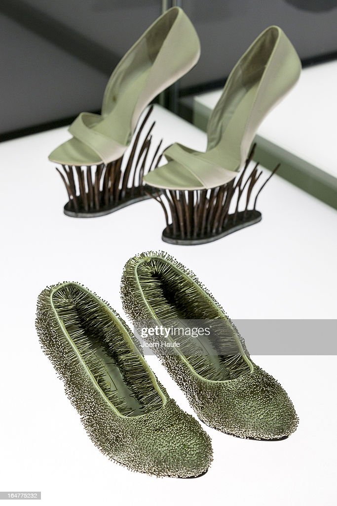 A pair of shoes with the name 'Pinned Shoes' designed by Erwina Ziomskowska and a pair of shoes with the name 'Nails' designed by Emmi Malmstroem and Jesse Sipola at the exhibition: 'Starker Auftritt: Experimentelles Schuh Design' (the title is a play on words, as it means both 'Strong Appearance' and 'Strong Step', coupled to 'Experimental Show Design') at the Grassi Museum on March 27, 2013 in Leipzig, Germany. The exhibition features over 200 pairs of shoes, many of them designed for celebrities and which challenge traditional notions of shoe design. The exhibition will run until September 28, 2013.