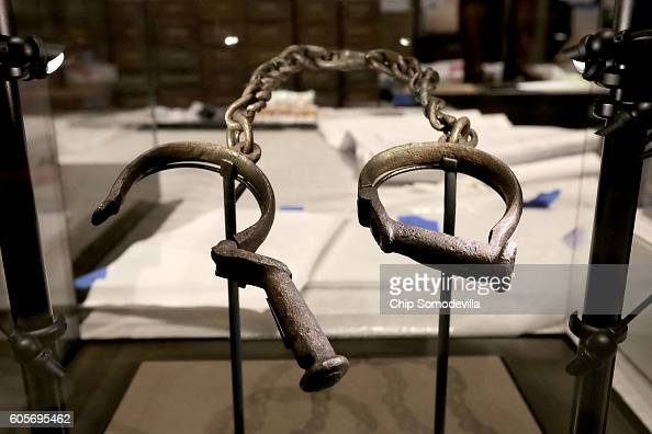 A pair of slave shackles are on display in the Slavery and Freedom Gallery in the Smithsonian's National Museum of African American History and...