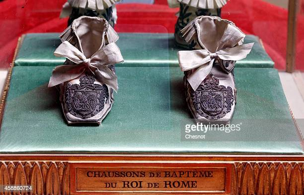 A pair of slipper baptism of the King of Rome from the Napoleonic collection of the Palais de Monaco is displayed on November 12 2014 in...