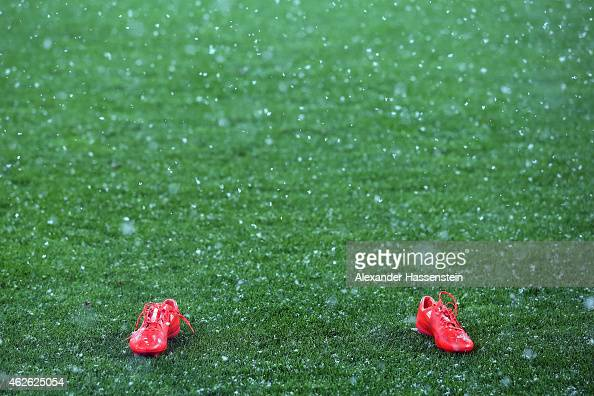 A pair of soccer boots is standing on the pitch prior to the Bundesliga match between FC Augsburg and 1899 Hoffenheim at SGL Arena on February 1 2015...