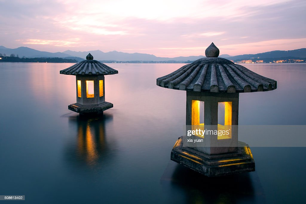 A pair of stone lanterns on the West Lake,Hangzhou : Stock Photo