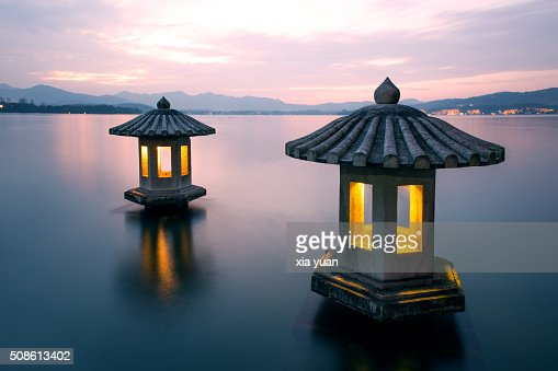 A pair of stone lanterns on the West Lake,Hangzhou : Stock Photo