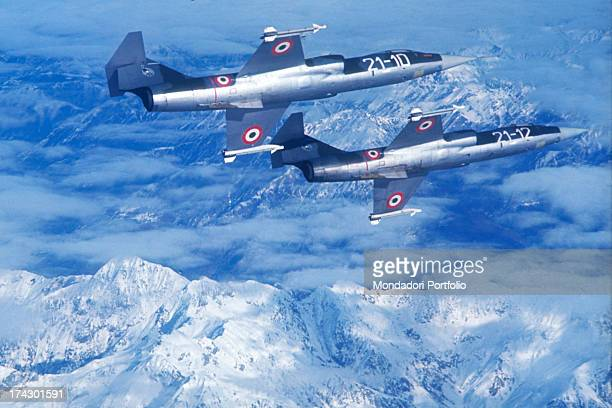 Pair of supersonic aircraft F104 G of the Italian Airforce 21 Squadron stationed at Cameri during a training flight over the Alps in 1970