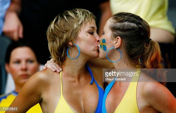 A pair of Swedish fans kiss prior to the FIFA World Cup Germany 2006 Group B match between Sweden and Paraguay played at the Olympic Stadium on June...