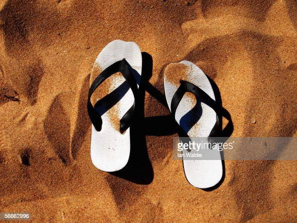 A pair of thongs lie in the sand on a beach January 21 2006 in Sydney Australia Thongs also known as 'Flip Flops' in Europe or 'Jandals' in New...