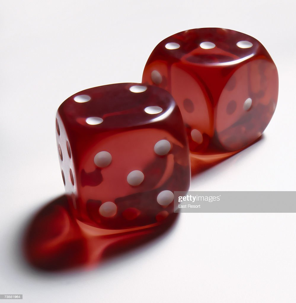 Pair of translucent red dice : Stock Photo