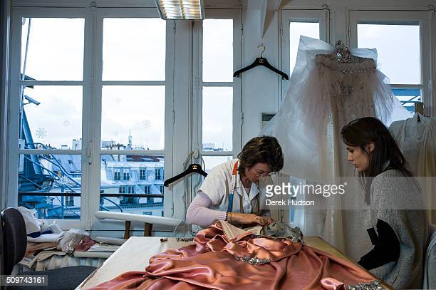 A pair of unidentified seamstresseses in the Chanel atelier work on one of Karl Lagerfeld''s designs for his fashion show Paris France 2010