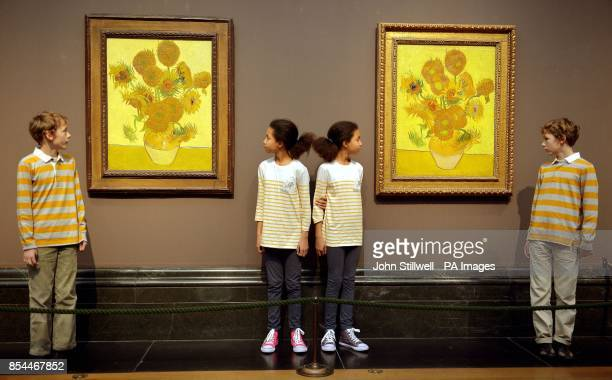 A pair of Vincent Van Gogh's Sunflower paintings hang sidebyside and are studied by twins Edgar and Gabriel and Eva and Ellie before going on show to...