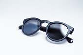 A pair of vintage and fashionable sunglasses isolated on a white background