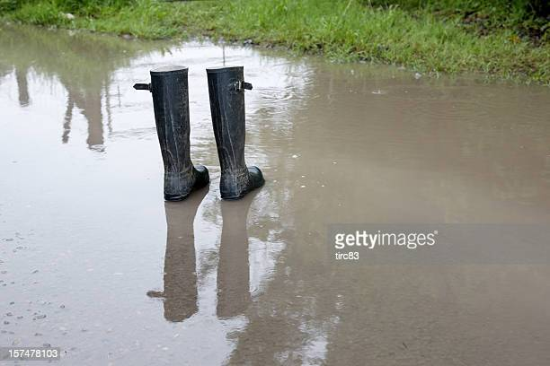 Pair of wellington boots in a puddle